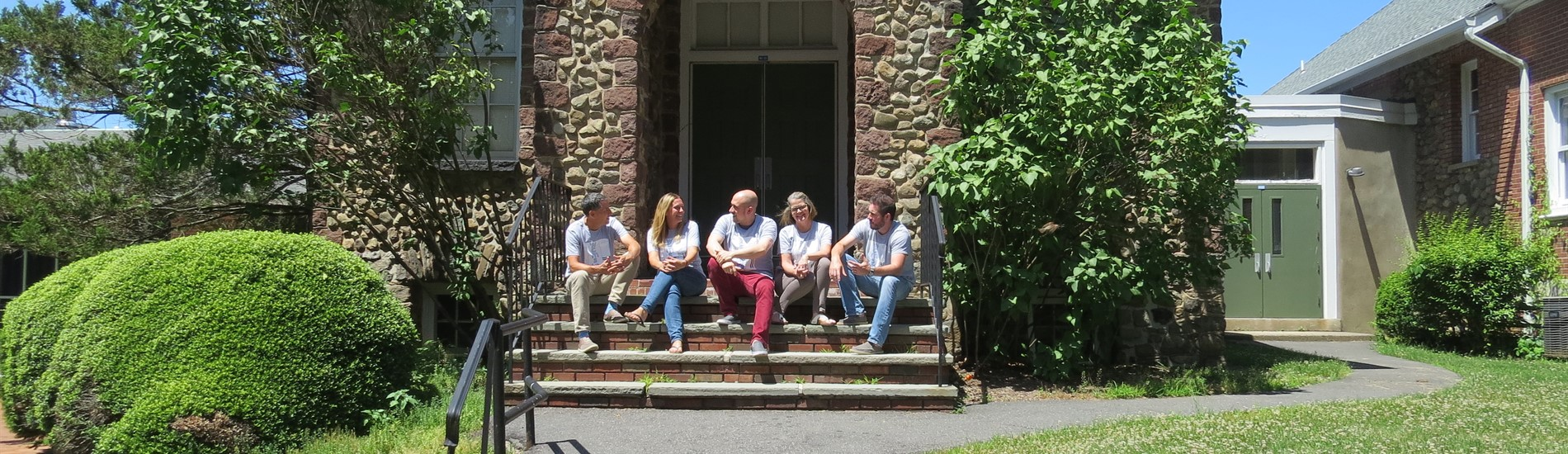 WCMS teachers in front of Old Schoolhouse