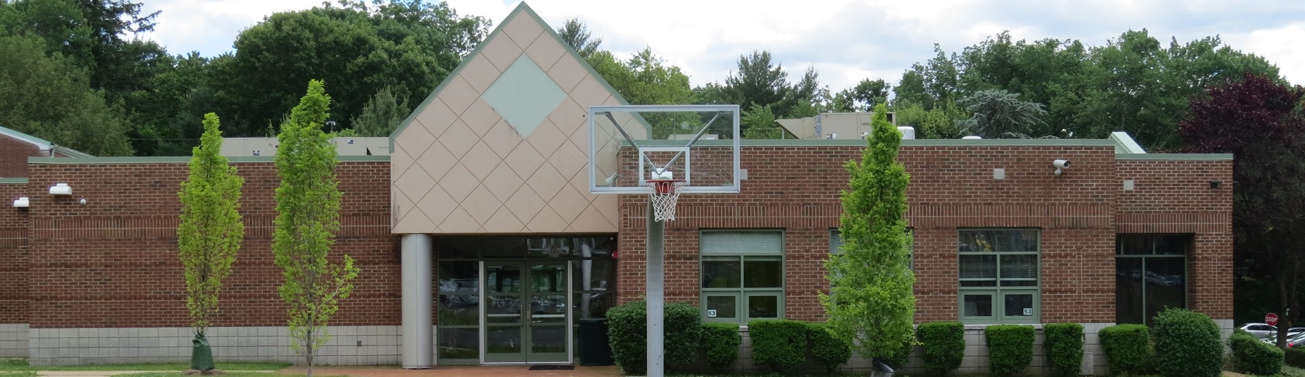 Woodcliff Middle School - back view of Media Center with basketball court
